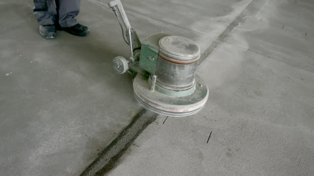 sanding the wet edges on concrete floor - concrete stock videos & royalty-free footage