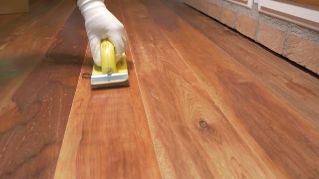 sanding wood flooring. - polishing stock videos & royalty-free footage
