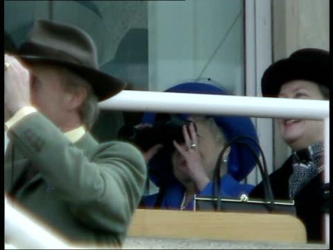 queen mother attends queen mother watching racing thru binoculars - binoculars stock videos & royalty-free footage