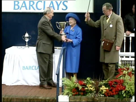 queen mother attends queen mother with her horse crowd applauds queen mother presented with cup oliver ellwood interview sot always a great honour to... - queen dowager stock videos and b-roll footage