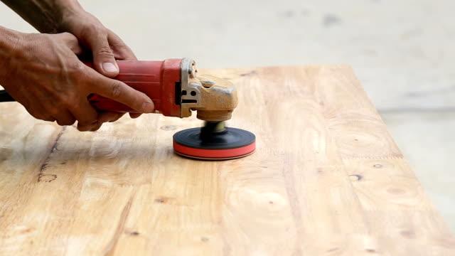 Sandpaper polishing machine.