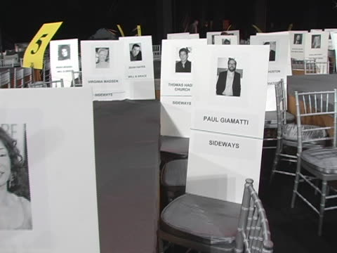 vídeos de stock, filmes e b-roll de sandra oh and paul giamattis seat cards at the 11th annual screen actors guild awards rehearsals at shrine auditorium in los angeles california - shrine auditorium
