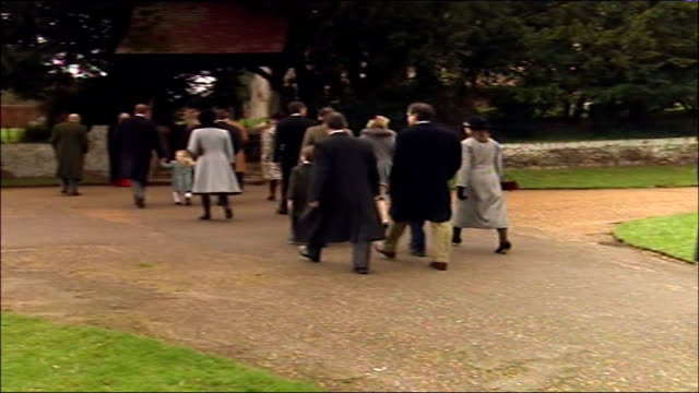 Royal family attend church ENGLAND Norfolk Sandringham St Mary Magdalen Church EXT Prince Edward and Prince Philip lead family along path to church...