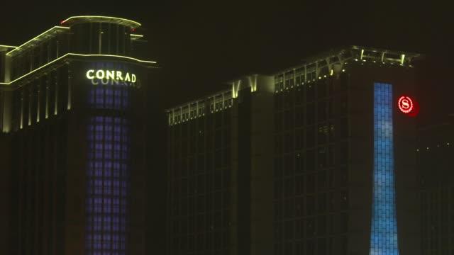 ms sands cotai central entertainment complex conrad macao sheraton macao hotels dark sky bg - cotai strip stock videos and b-roll footage