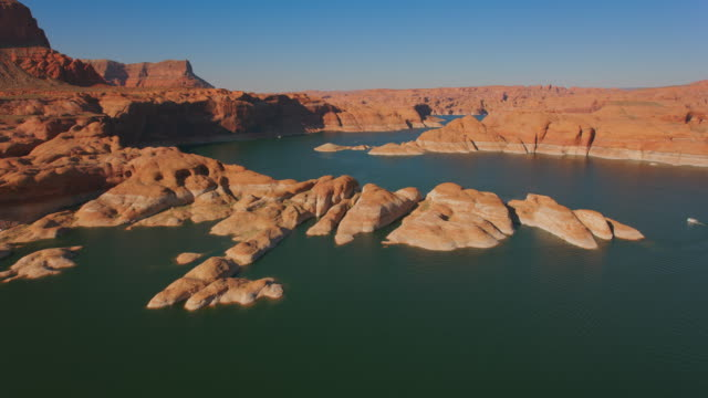 aerial sandstone buttes on lake powell, usa - lake powell stock videos & royalty-free footage