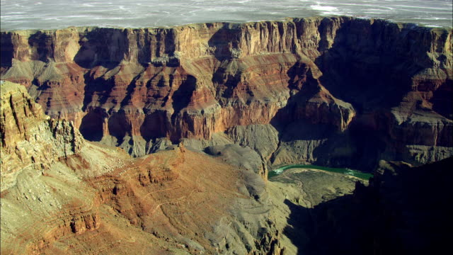 sandstone cliffs tower over the colorado river in the grand canyon. - river colorado stock videos & royalty-free footage