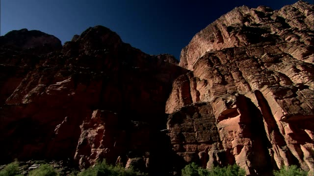 sandstone cliffs tower over the grand canyon. - sandstone stock videos & royalty-free footage