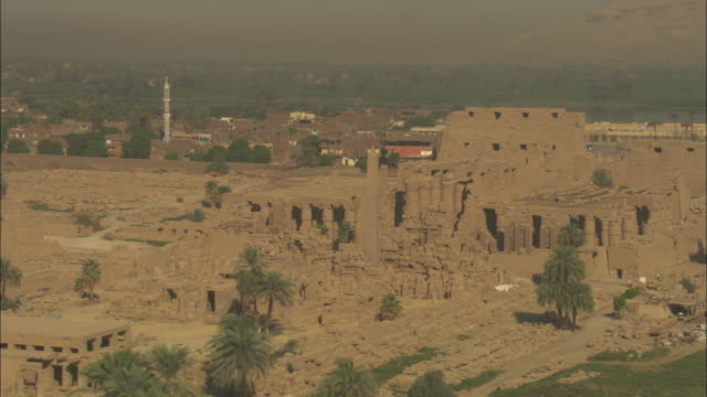 sandstone historical ruins with large pillars stand out in the egyptian nile delta. - sandstone stock videos & royalty-free footage