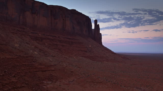 sandstone mesa in monument valley at dusk - drone shot - navajo reservation stock videos and b-roll footage