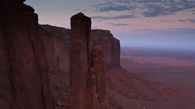 sandstone pinnacle in monument valley - drone shot - navajo reservation stock videos and b-roll footage