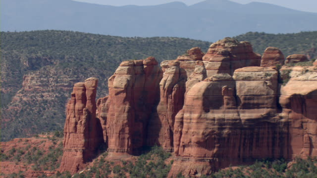 sandstone rock formations characterize a desert near sedona, arizona. - sedona stock videos & royalty-free footage