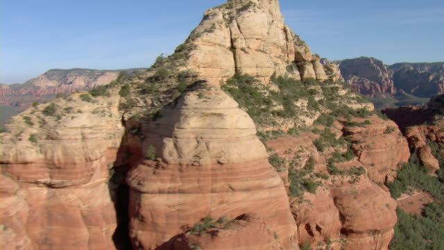 sandstone rock formations characterize the desert near sedona, arizona. - sedona stock videos & royalty-free footage