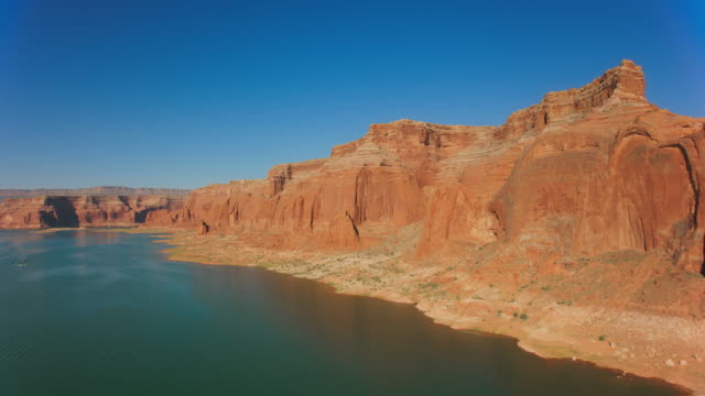 aerial sandstone walls rising above lake powell - lake powell stock videos & royalty-free footage