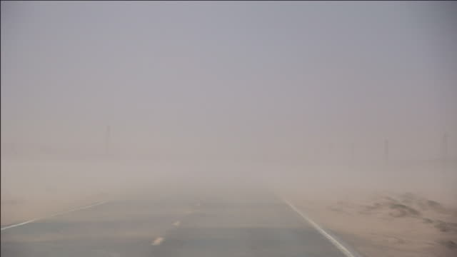 a sandstorm blows across highway 191 near the hubbell trading post. - sandstorm stock videos & royalty-free footage