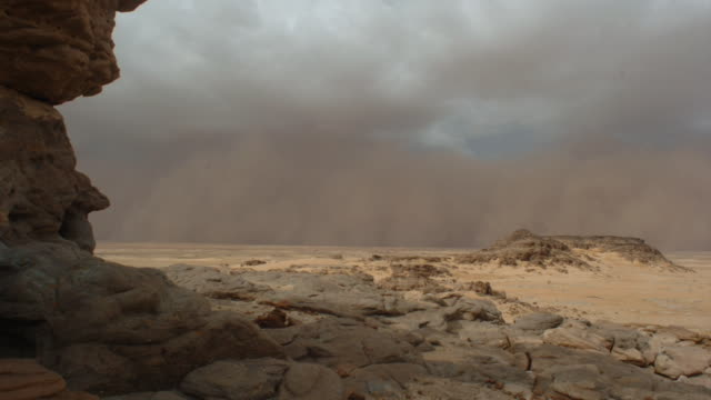 a sandstorm blows through a desert. available in hd. - desert stock videos & royalty-free footage