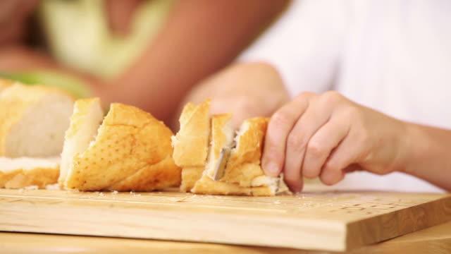 sandwich and fillings getting sliced - サンドイッチ作り点の映像素材/bロール
