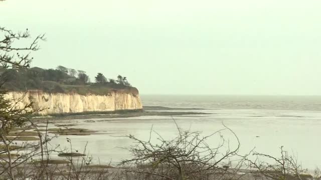 sandwich coast views; england: kent: sandwich: ext various of the kent coastline at sandwich including sea, beach, white cliffs, town, marshes/dunes - sand dune stock videos & royalty-free footage