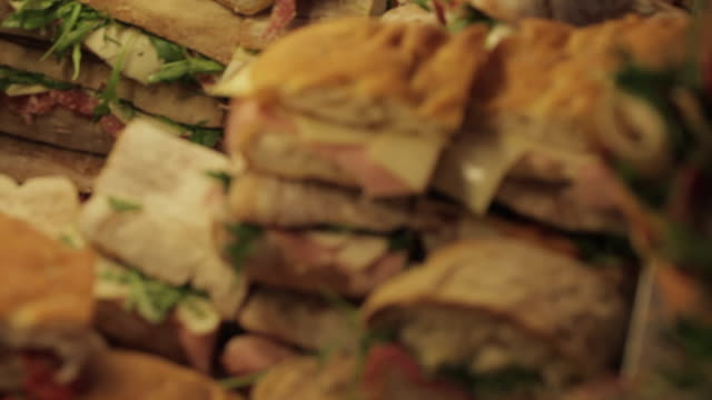 sandwich making, borough market, london, england, uk, europe - sandwich stock videos & royalty-free footage