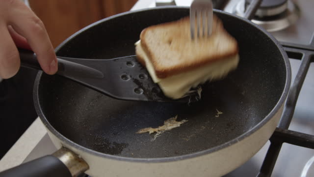 sandwich on a frying pan with toast bread and cheese shot on red camera - sandwich stock videos & royalty-free footage