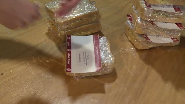 sandwiches being provided for the local community by stevenage fc during the coronavirus crisis - packing stock videos & royalty-free footage