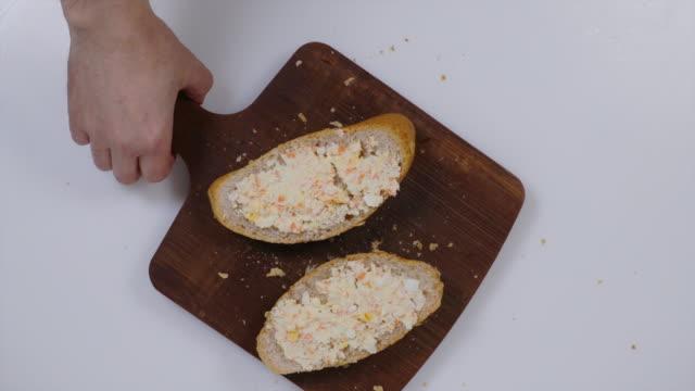 sandwiches with crab salad. - annick vanderschelden stock videos & royalty-free footage