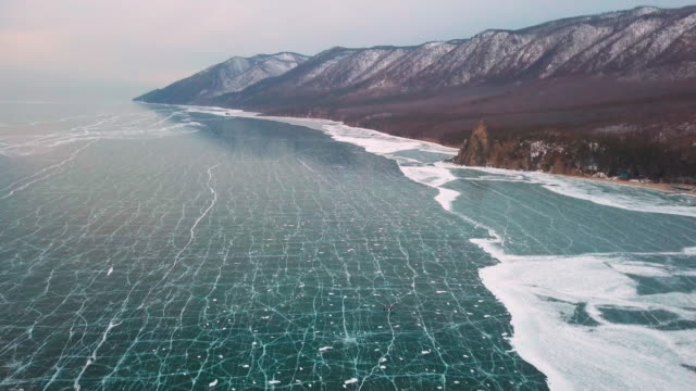 sandy bay (peschanaya bay) on lake baikal in winter. siberia, russia, aerial view - russian culture stock videos & royalty-free footage