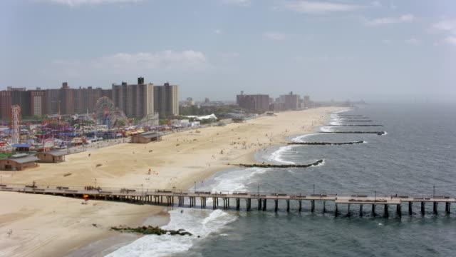 aerial sandy beach on coney island along the amusement park - coney island brooklyn stock videos & royalty-free footage