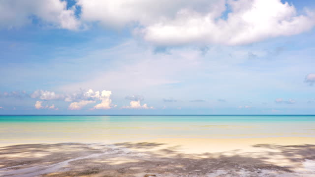 sandy beach, paradise like, sky filled with clouds. travel destinations - beach holiday stock videos & royalty-free footage