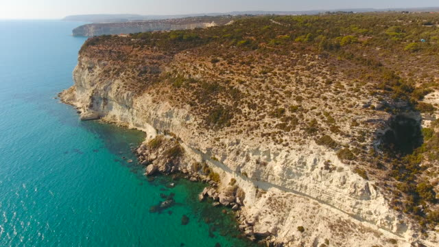 Sandy Cliff above Turquoise Colored Sea Water. Cyprus. Aerial drone shot.