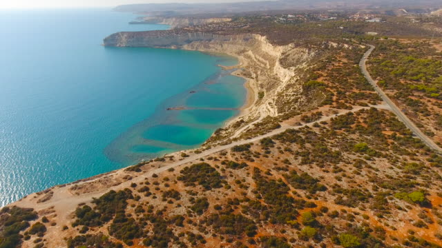 sandy cliff above turquoise colored sea water. cyprus. aerial drone shot. - republic of cyprus stock videos & royalty-free footage