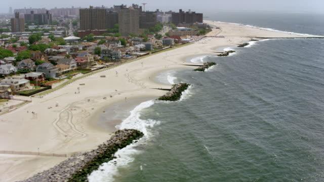 aerial sandy coastline of coney island, new york - coney island stock videos and b-roll footage