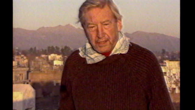 sandy gall honoured by queen; date unknown afghanistan: ext sandy gall doing report to camera gall along through mountain pass on donkey letterbox... - letterbox stock-videos und b-roll-filmmaterial