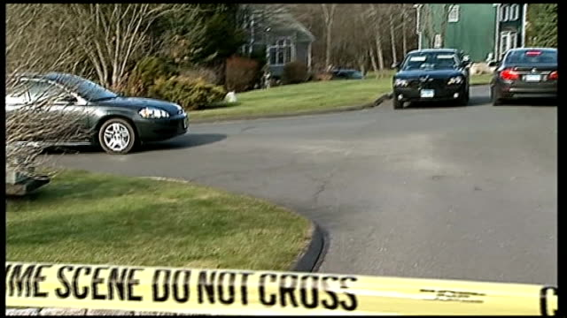 invesitgation continues / reactions ext police tape sealing off road where sandy hook elementary school killer adam lanza lived with his mother nancy... - newtown connecticut stock videos & royalty-free footage