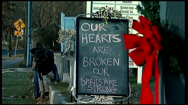 invesitgation continues / reactions usa connecticut newtown sandy hook ext blackboard with message our hearts are broken our spirits are strong sign... - newtown connecticut stock videos & royalty-free footage