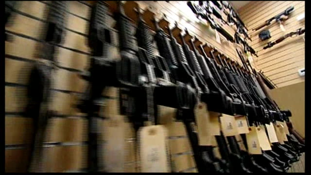 gun control t24071217 rifles on display in gun shop - gun shop点の映像素材/bロール