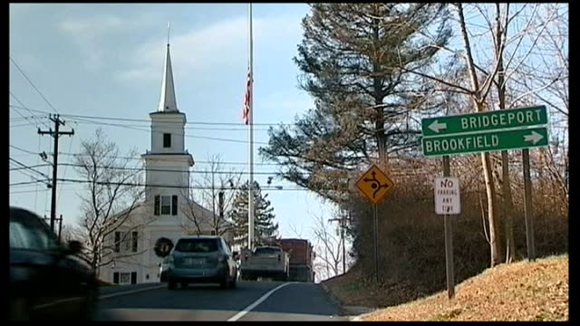 emergency calls made public usa connecticut newtown cars along road with 'bridgeport and brookfield' with white church and half mast flag in... - newtown connecticut stock videos & royalty-free footage