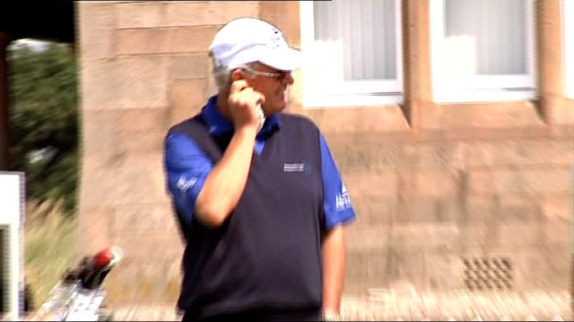 Ayrshire Royal Troon EXT Sandy Lyle on practice putting green along with other unidentified golfers