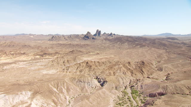 ws aerial pov sandy rocky foothills with canyons and dry river beds approaching picacho peak / california, united states  - riverbed stock videos & royalty-free footage