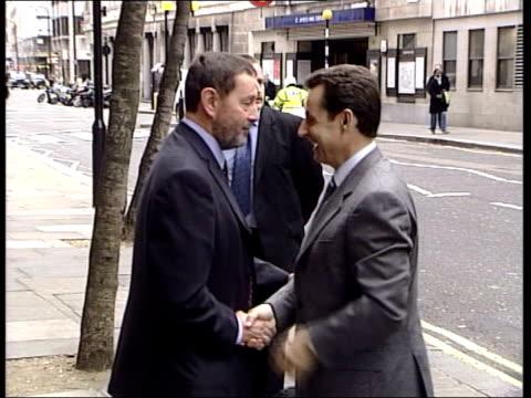 asylum seekers allowed to enter britain; itn england: london: ext french interior minister nikolas sarkozy out of car as greeting david blunkett mp... - david blunkett stock videos & royalty-free footage