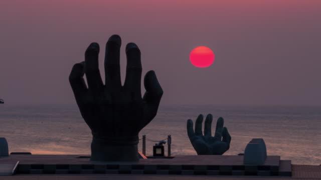 sangsaeng's hand at sunrise / pohang-si, gyeongsangbuk-do, south korea - sculpture stock videos & royalty-free footage