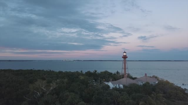 sanibel island lighthouse at sunset - coastline stock videos & royalty-free footage