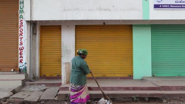A sanitation worker sweeps the ground in Mysuru Karnataka India on Tuesday Nov 21 2017