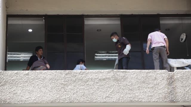 Sanitation workers clean the sidewalks at the blast site near the Erawan Hindu shrine in Bangkok Thailand on August 17th 2015 Shots Sanitation...