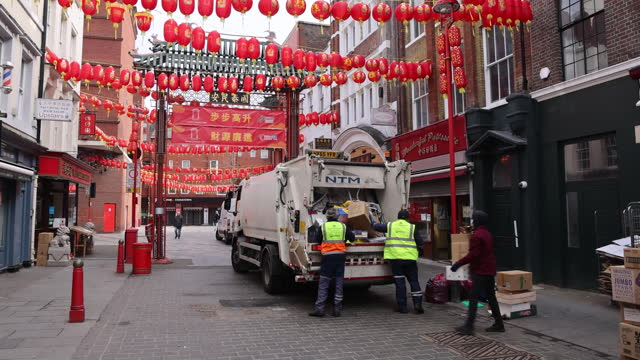 sanitation workers collecting garbage from street in chinatown in london, england, uk, on monday, march 1, 2021. - chinese culture stock videos & royalty-free footage
