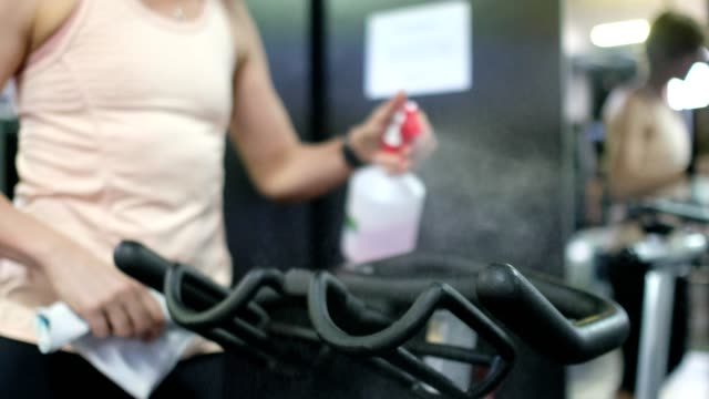 sanitizing exercise equipment in the gym - exercise equipment stock videos & royalty-free footage