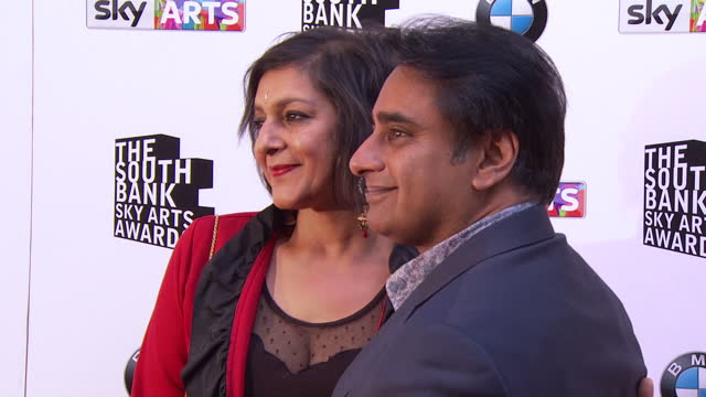 sanjeev bhaskar and meera syal arriving and posing for photos on red carpet. sky arts awards honouring best of theatre, film, music and art take... - meera syal stock videos & royalty-free footage