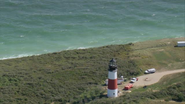 AERIAL Sankaty Head Lighthouse on coastline / Nantucket, Massachusetts, United States