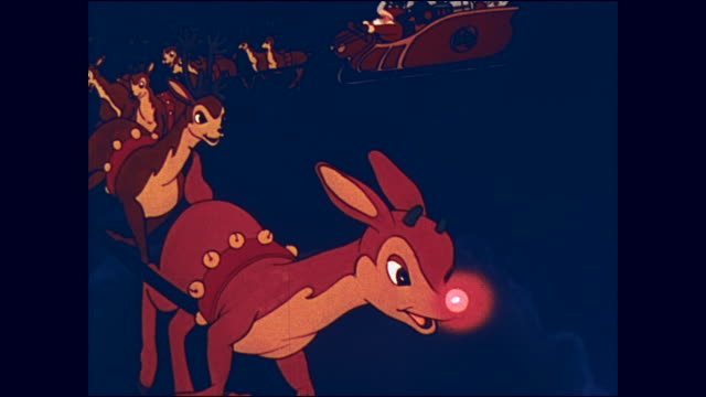 vidéos et rushes de santa and his reindeer, led by rudolph, deliver toys for christmas - jouet