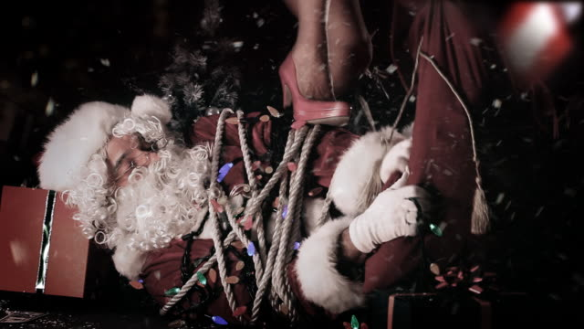 santa attack - frau gefesselt stock-videos und b-roll-filmmaterial
