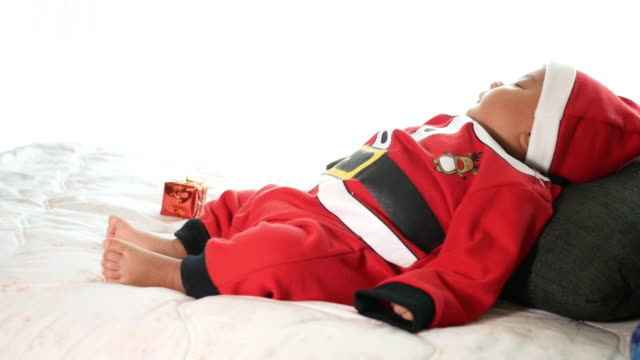 santa baby with christmas tree - santa hat stock videos and b-roll footage